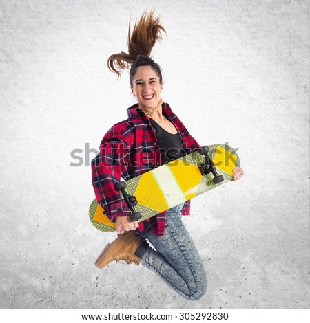 Happy woman jumping with skate