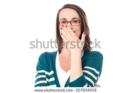 Happy woman laughing covering her mouth with hand - stock photo