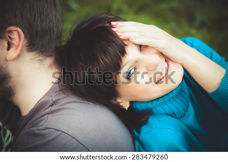 happy woman laughing leaning on her man - stock photo