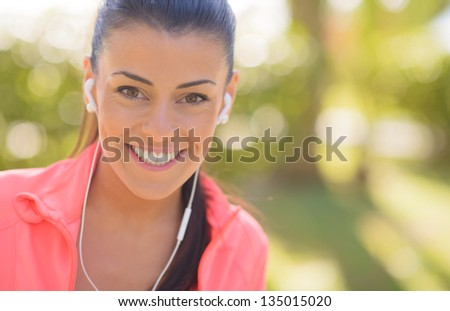 Happy Woman Listening To Music, Outdoors - stock photo