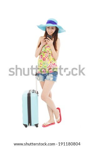happy woman looking the smart phone with  travel baggage - stock photo