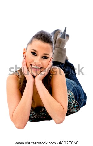 Happy woman lying on the floor isolated on white