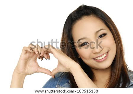 Happy woman makes a heart with her hands as a symbol of love - stock photo