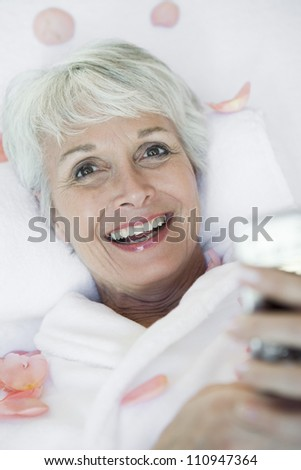 Happy woman making cellphone call - stock photo