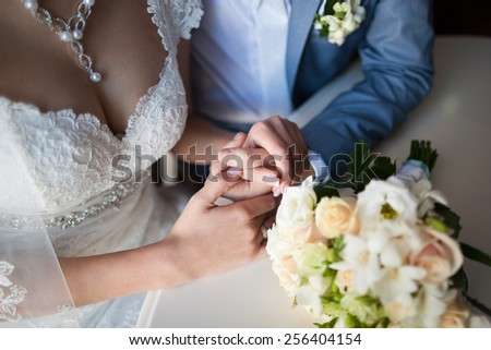 happy woman, man sitting at table in cafe, restaurant. beautiful couple of young people talking, holding hands, smiling. wedding reception. portrait of happy persons in love. new family lifestyles - stock photo