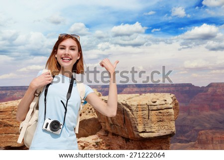 Happy Woman mountain Hiker or traveler with backpack enjoy view in grand canyon - stock photo