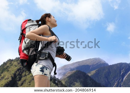 happy woman mountain hiker with backpack and looking to sky on the top of mountains. asian - stock photo