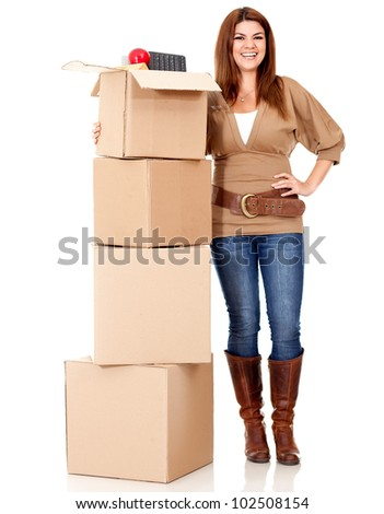 Happy woman moving house and packing in boxes - isolated over white - stock photo