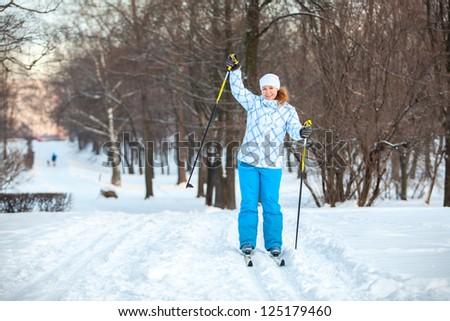 Happy woman on cross ski riding on snow with copyspace - stock photo