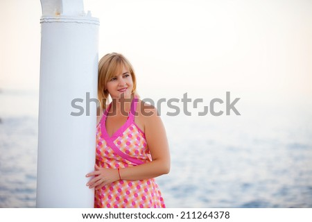 Happy woman on cruise ship - stock photo