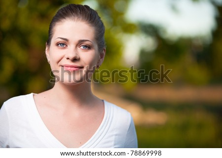 Happy  Woman on summer tree background. Outdoor portrait with big smile. - stock photo