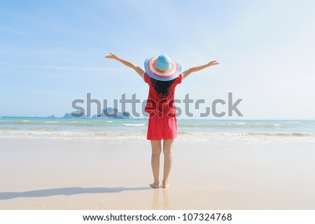 Happy woman on the beach in Krabi Thailand - stock photo
