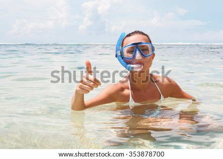 Happy woman on the beach with a diving mask. Stock image. - stock photo
