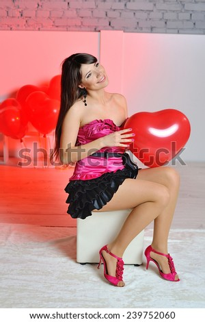 happy woman on Valentine's Day is sitting in the studio. - stock photo