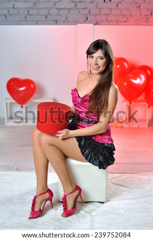 happy woman on Valentine's Day with a gift in their hands. - stock photo