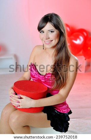 happy woman on Valentine's Day with red gift in hands. - stock photo