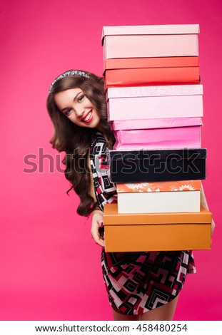 Happy woman out shopping. The lady had a lot of boxes, shopping bags. Stylish girl enjoys shopping, holding many boxes. Summer holiday, vacation, spend money on shopping - stock photo