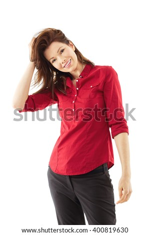 Happy woman play with her hair, isolated over white background - stock photo