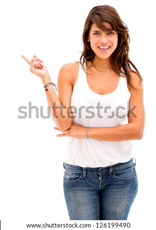 Happy woman pointing to the side - isolated over a white background - stock photo