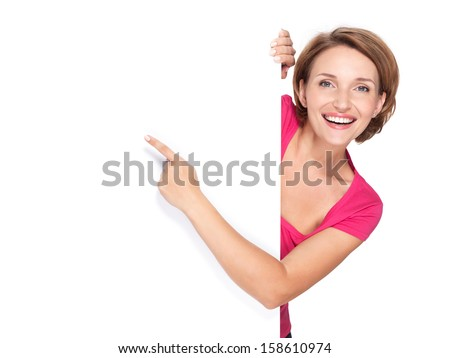 happy woman pointing with her finger on banner isolated on white background - stock photo