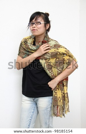Happy woman portrait with colorful scarf. Isolated on white background - stock photo