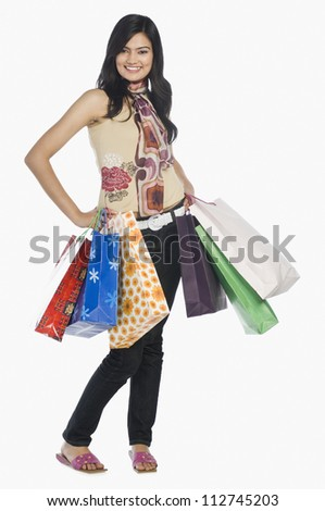 Happy woman posing with shopping bags