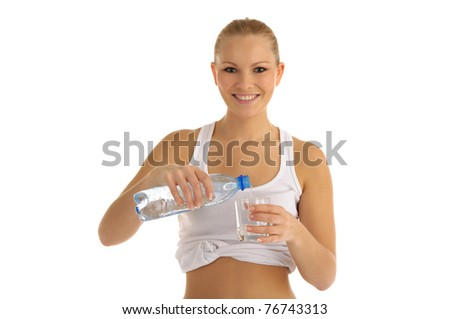 happy woman pours water into a glass isolated on white