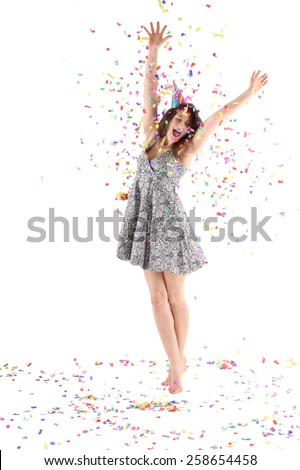 Happy woman raised hands with confetti - stock photo