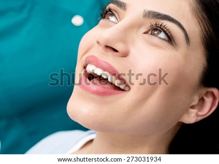 Happy woman ready for her dental examine
