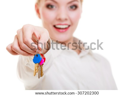 Happy woman real estate agent holding set of keys to new house or car. Property business and accomodation or home buying ownership concept, isolated on white background - stock photo