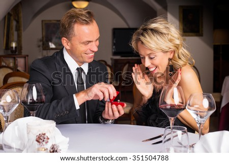 Happy woman receiving engagement ring  - stock photo