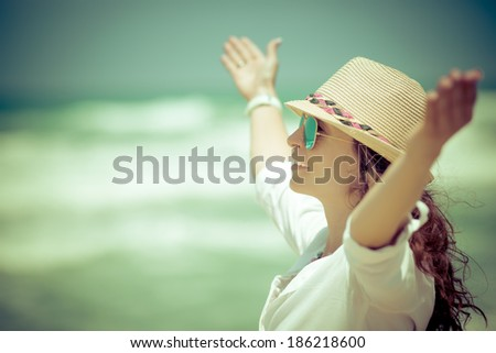 Happy woman relaxing at the beach. Summer vacations concept - stock photo
