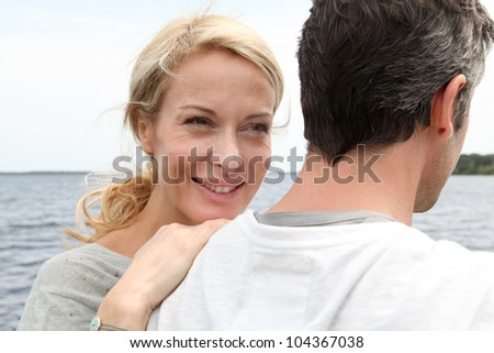Happy woman relaxing on husband's shoulder - stock photo