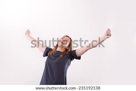 happy woman rising out her arms embracing the love for joy and life - stock photo