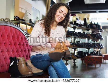 Happy woman shopping in the fashion shoe store