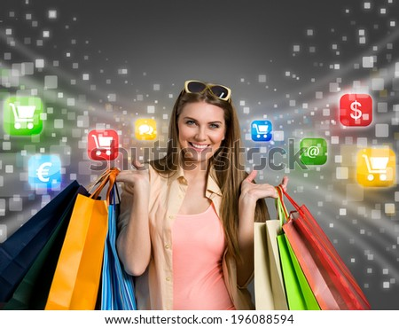 Happy woman shopping online with colorful icons in background - stock photo