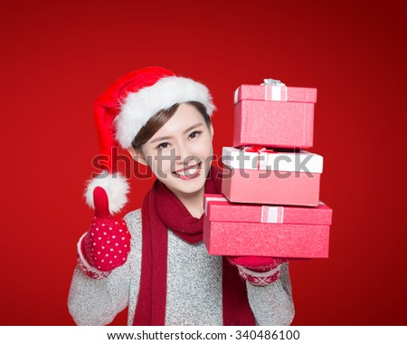 Happy woman show christmas gift and give thumb up gesture, asian - stock photo
