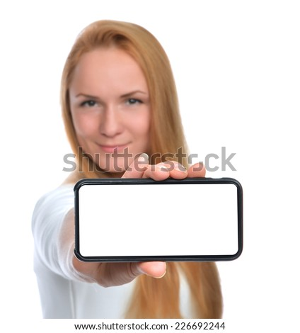 Happy woman show display of mobile cell phone with blank screen and smiling on a white background. Focus on hand with mobile phone - stock photo