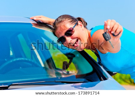 happy woman showing keys of her new car - stock photo