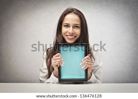 happy woman shows tablet - stock photo