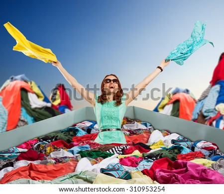 Happy woman sitting in clothes - stock photo
