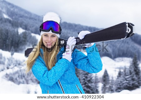 Happy woman skiing and enjoying the winter