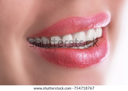 Happy woman smile with great white teeth. Dental care concept.