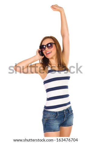 Happy woman smiling and talking on the phone. Three quarter length studio shot isolated on white. - stock photo