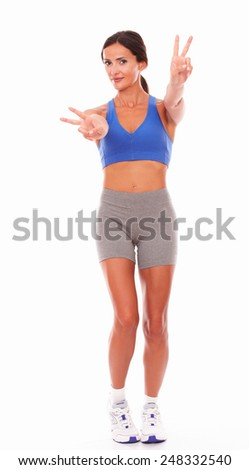 Happy woman smiling and wearing sport clothing on isolated background - copyspace - stock photo