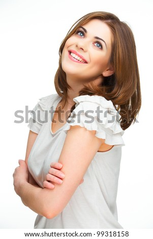 Happy woman standing against white background. Confident model pose with arms - stock photo