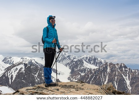 happy woman standing on mountain