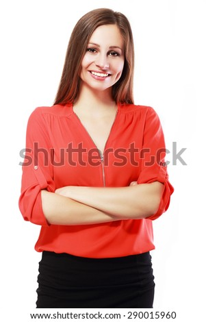 Happy woman standing with arms folded isolated on a white background. Looking at camera - stock photo