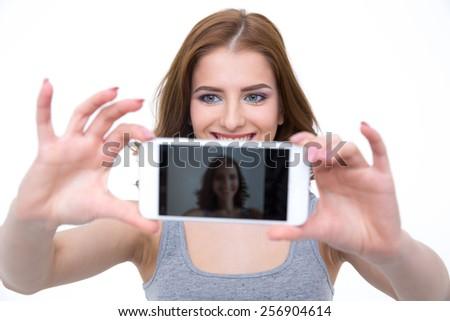 Happy woman taking selfie photo on smartphone - stock photo