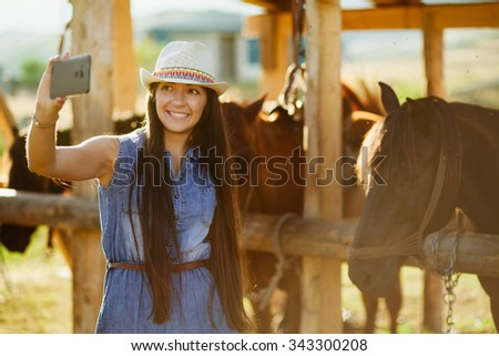happy woman taking selfie photo with horse - stock photo